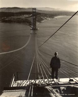 Footbridge ropes stretch across the Golden Gate Bridge under construction. San Francisco, California, September 1935.  Photograph by Charles M. Hiller.  The bridge celebrated its 75th anniversary this past Sunday!