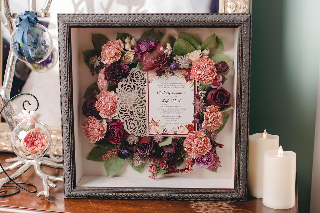 Preserved bridal bouquet and wedding invitation in