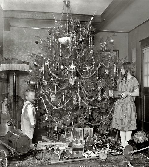 Tumblr    Decorating the Christmas Tree c. 1920