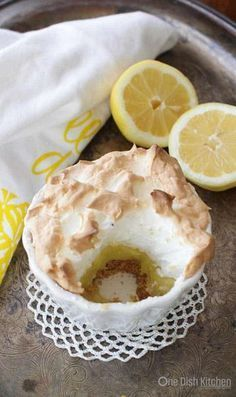 Meringue Pie For One baked in a ramekin. This single serving Lemon Meringue Pie has a big fluffy toasted meringue topping, a perfectly balanced sweet and tart lemon filling and a crisp graham cracker crust. Easy to make and the perfect size for anyone cooking for one. | One Dish Kitchen