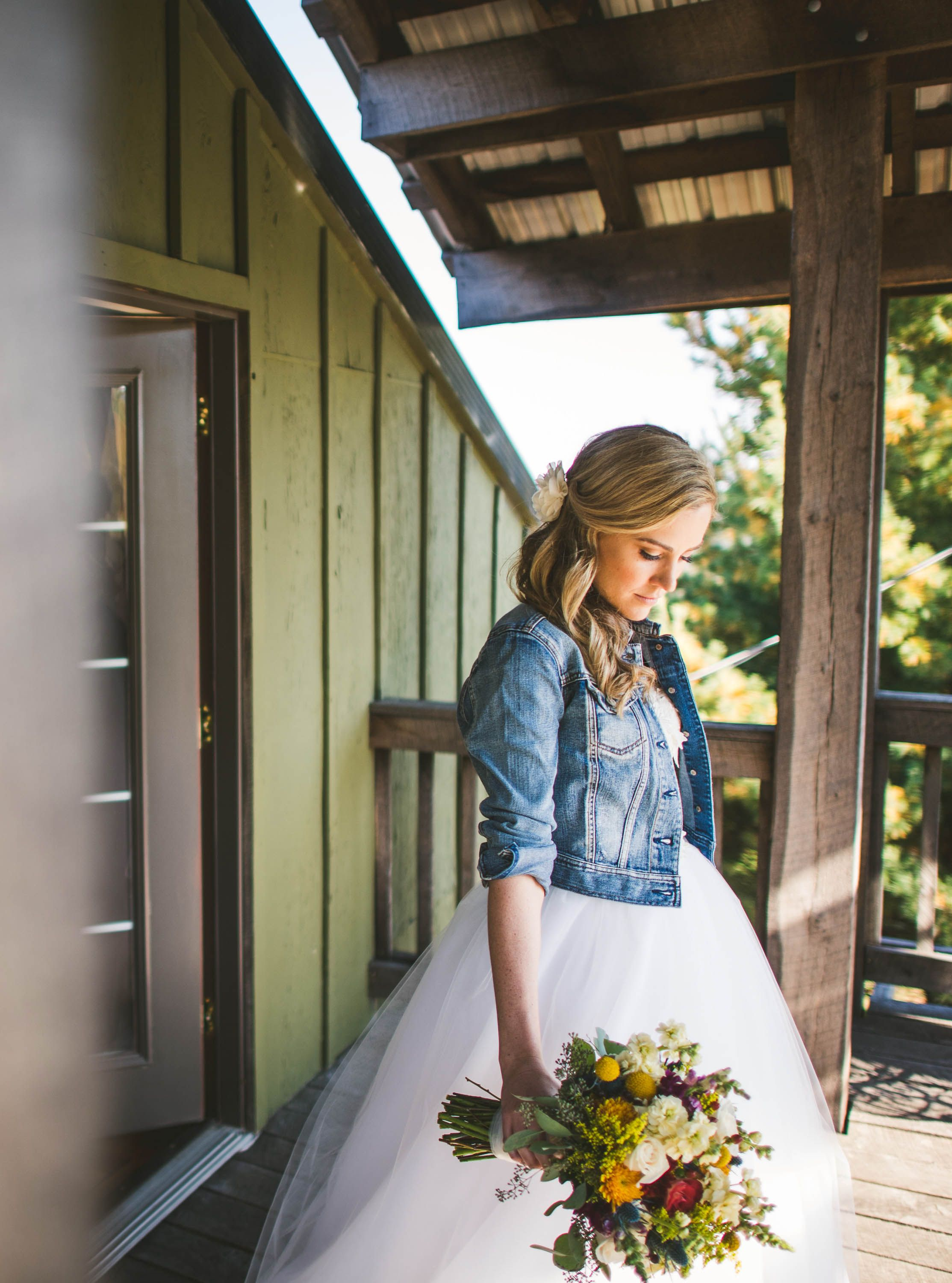 c6d5fc359c47 rustic wedding dress with jean jacket and autumn flowers