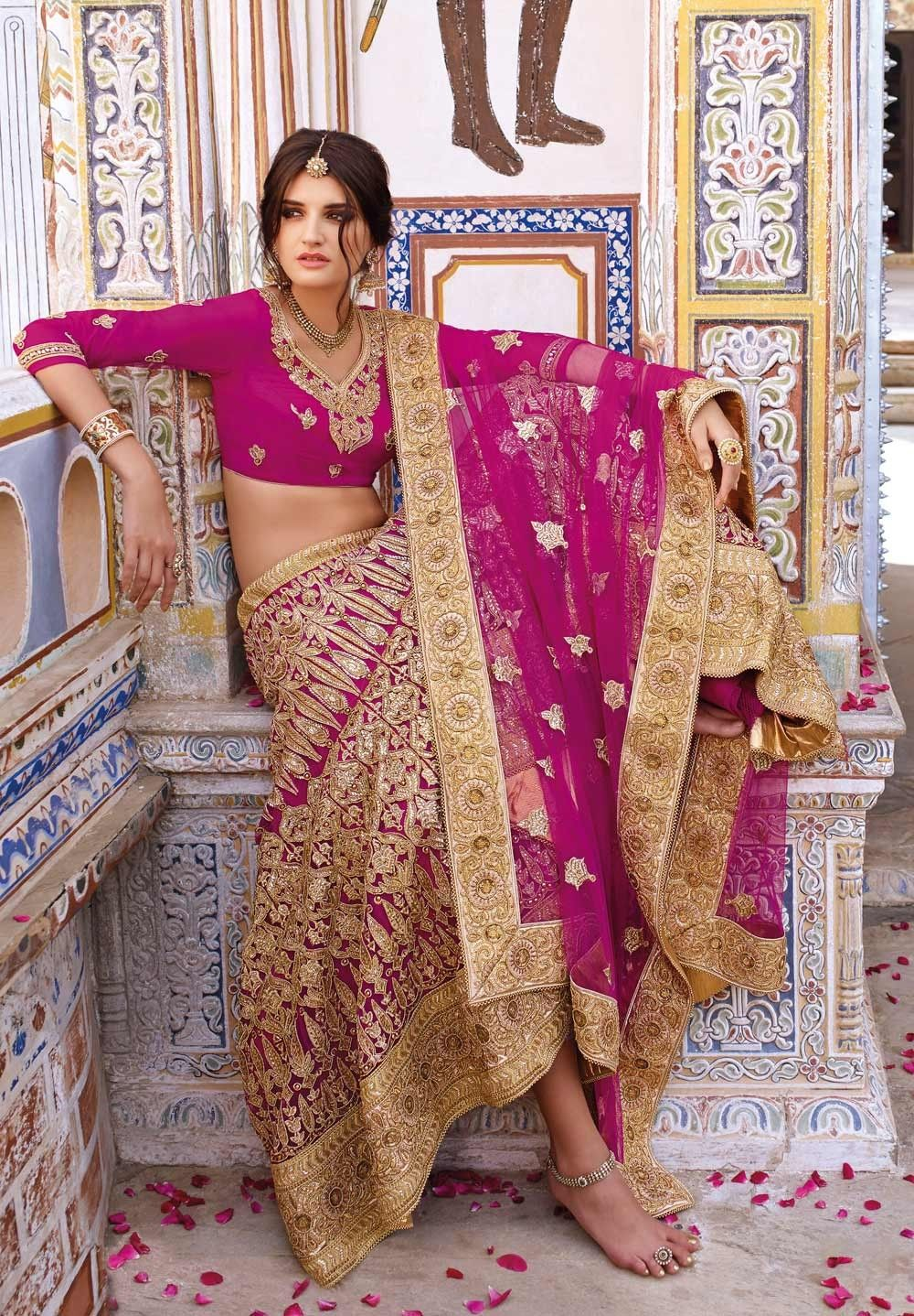Heavy embroidered Indian Punjabi raw silk lehenga choli in Magenta