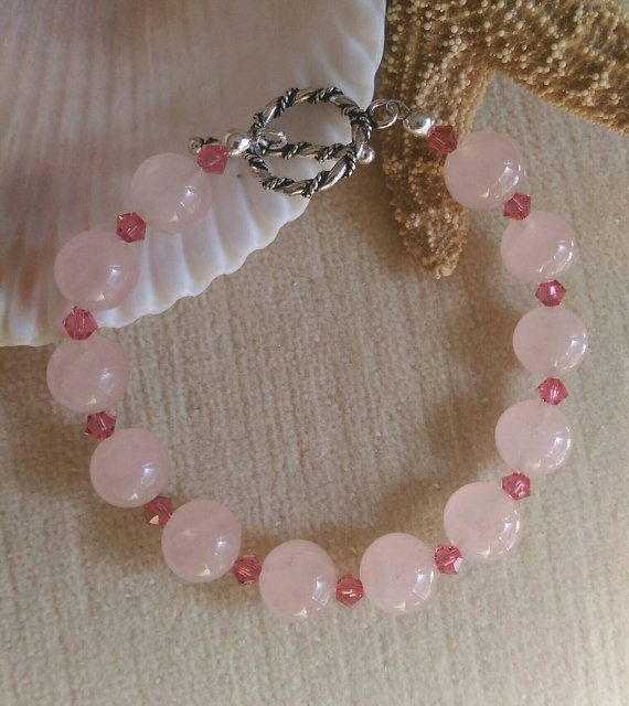 Rose Quartz Bracelet ! Handcrafted with Sterling Silver and twinkling pink Swarovski crystals!  Check out this item in my Etsy shop https://www.etsy.com/listing/287517261/rose-quartz-beaded-bracelet-handcrafted