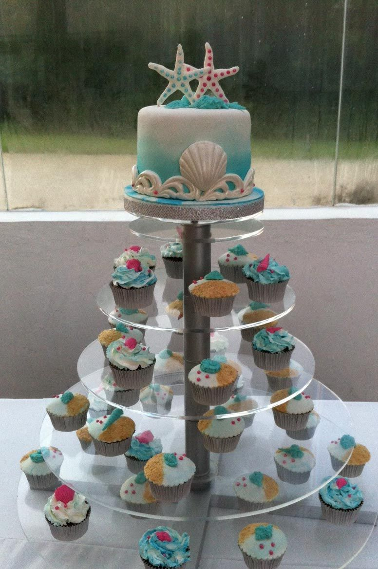 Wedding cupcakes and small cake. Sea theme decorated with