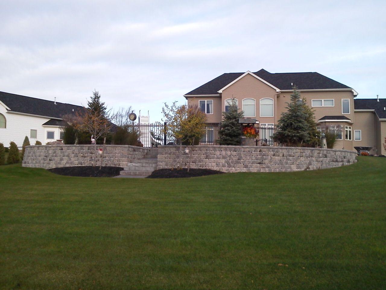 Wall And Steps Around An Inground Pool On A Slope Backyard Pool Landscaping Sloped Backyard Backyard Pool
