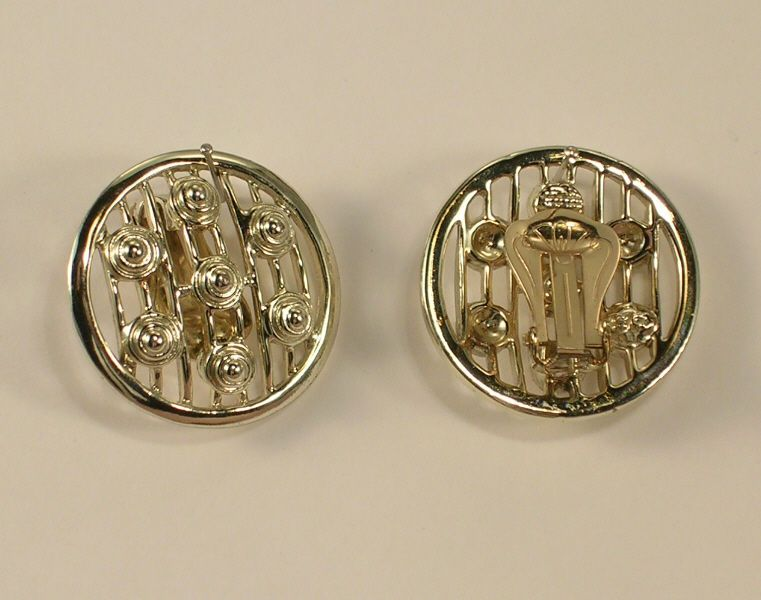 Silver Colored Metal Clip On Earrings with Raised Round Stylized Designs #Unmarked #Huggie