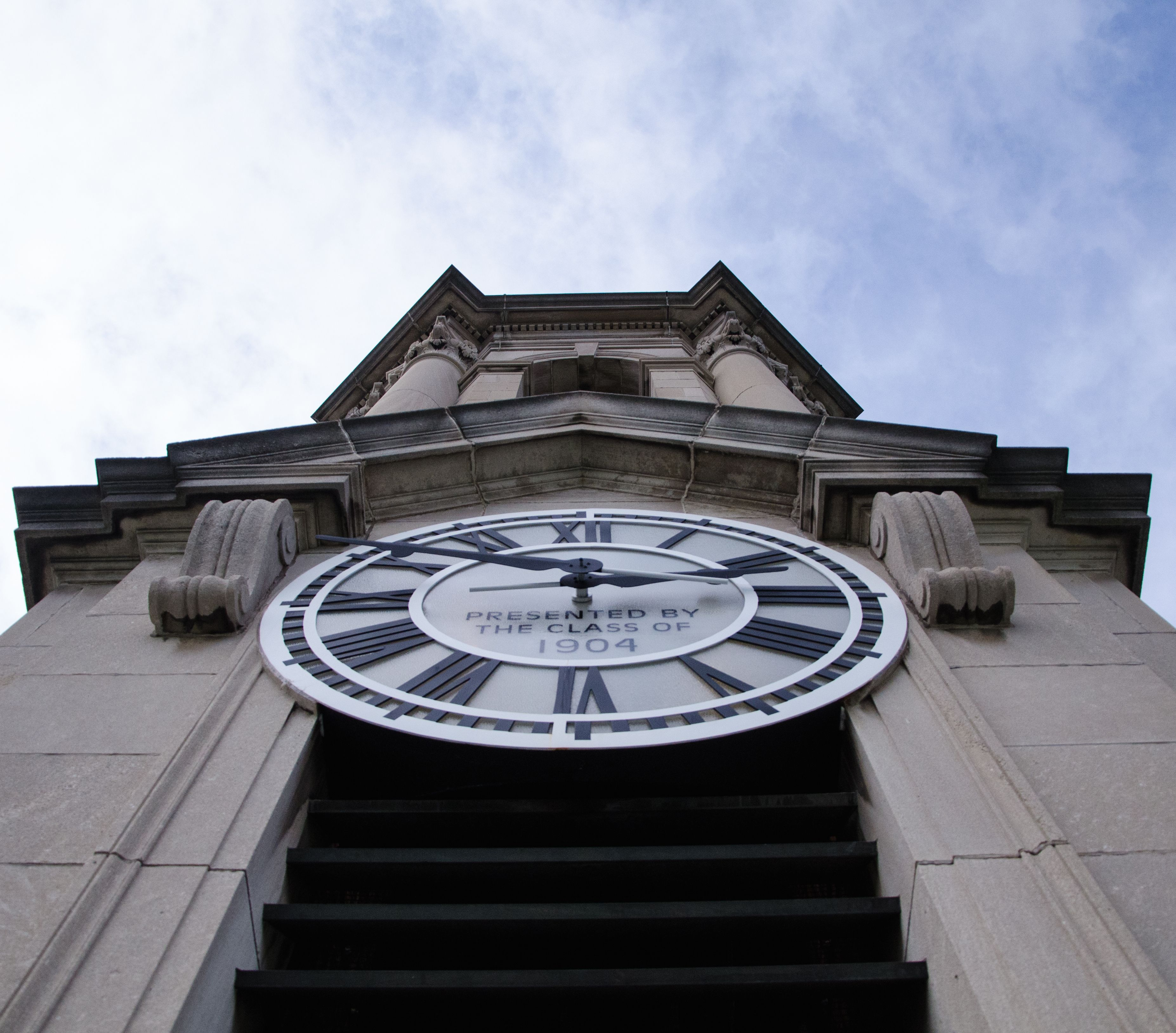 In October, students had a chance to climb the narrow stairs to the bell tower and get a close look at the Old Main clock seen here from just below it.