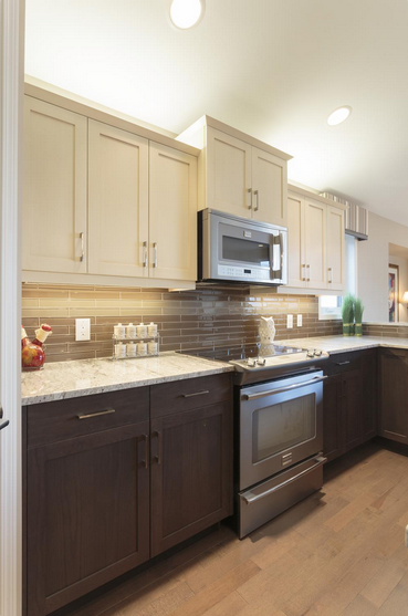 This Two Tone Transitional Kitchen Combines Light And Dark Cabinets Interiordesign Homedec New Kitchen Cabinets Kitchen Renovation Two Tone Kitchen Cabinets