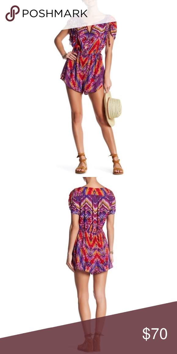 2051a42b3364 Free People Dream All Night Romper NWT The Dream All Night Romper brings a  fun pop of color to your wardrobe. Fit  this style fits true to size.