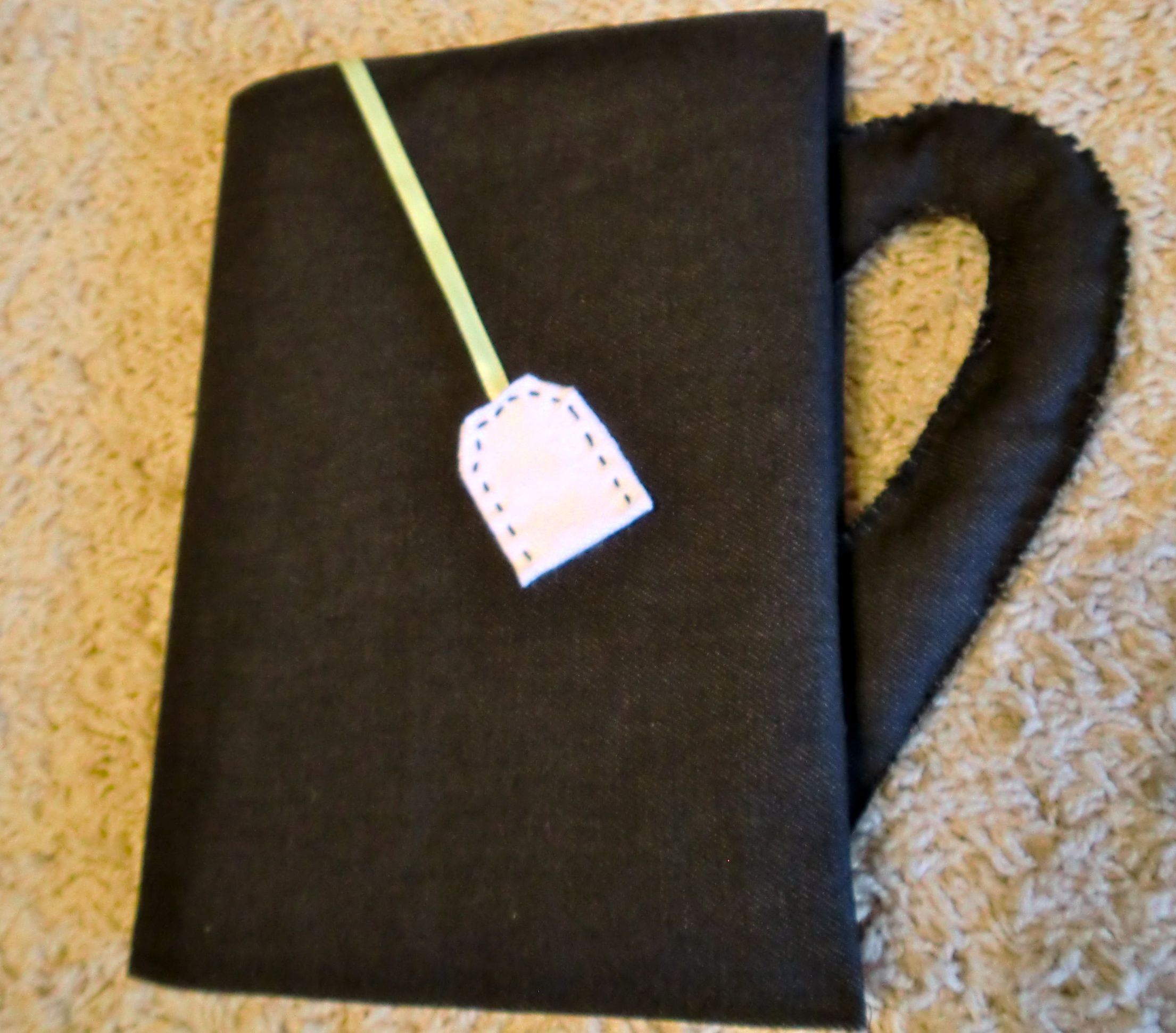 homemade tea cup book cover  http://thinkimight.wordpress.com/2011/12/13/coverabook/