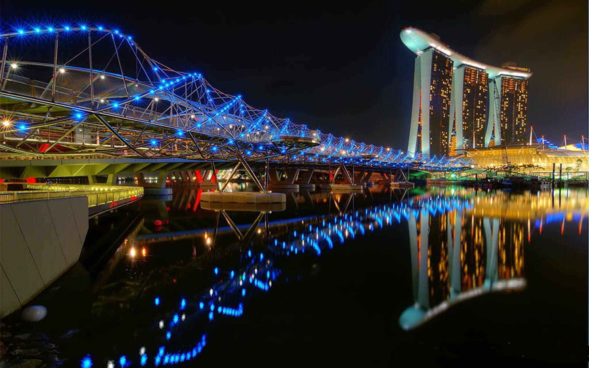 Singapore S Incredibly Light Helix Bridge Woe Sands Hotel Singapore Romantic Destinations Singapore Destinations