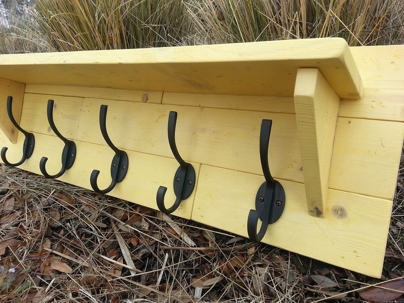 Rustic Plank Coat Rack with oiled bronze hooks stained in Harvest Yellow. Made from several individual pieces to recreate that farmhouse feeling, distressed by hand, and finished in stain.