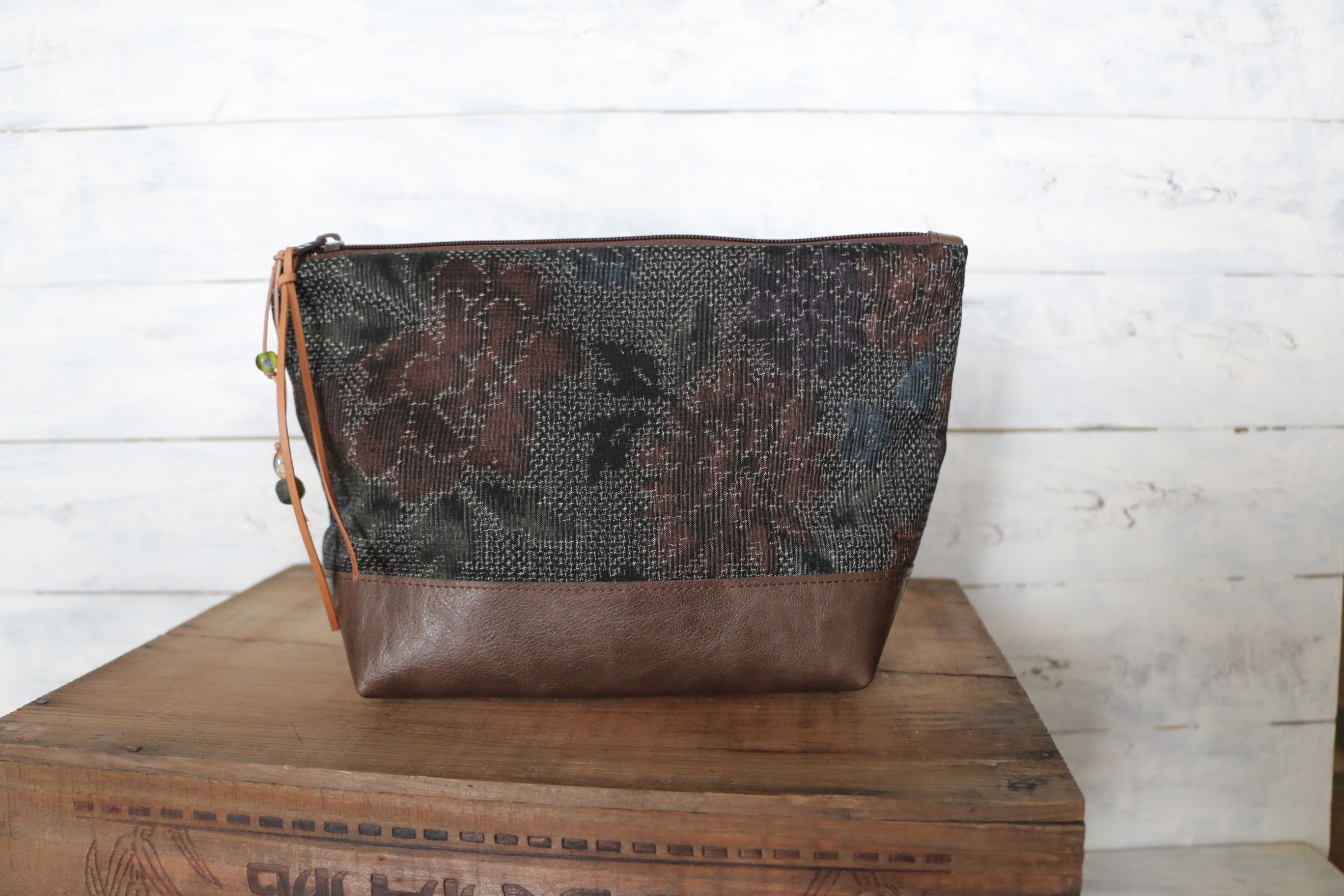 This beautiful Large size Kimono × Leather Pouch is made of Flower motif Japanese Vintage woven Kimono fabric ( 100% Silk ) and Beautiful Italian brown leather.This Pouch can be as a makeup pouch, Travel Pouch ,Utility Pouch etc.....  << Approx.measurements >> W 10.6 inches ( 27 cm ) TOP /// W 6.9 inches ( 17.5 cm ) Bottom /// H 6.3 inches ( 16 cm ) Gusset along bottom 3.95 inches ( 10 cm ) $62 https://www.etsy.com/listing/201000397/large-size-utility-pouch-japanese