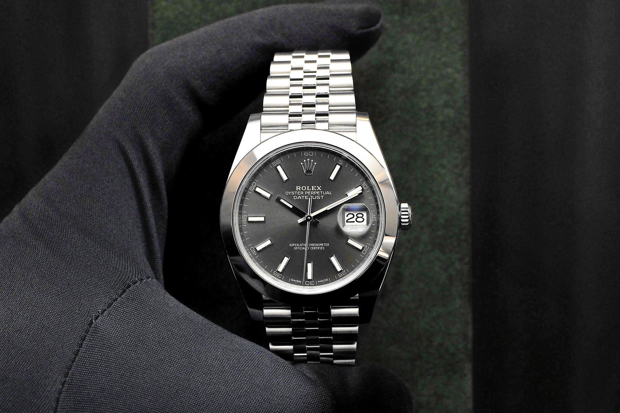 One of the more interesting watches to come from Rolex this year was the Rolex Datejust 41 in steel with a Dark Rhodium dial and Jubilee five-piece link bracelet. With a larger case size (41 mm in diameter), a smooth (not fluted) bezel, and 18K white gold indexes on top of a real rhodium plated dial, Rolex has made a watch that is aesthetically much more pleasing to my eye. The Datejust, quite frankly, has never appealed to me, until now. Rolex Datejust 41 in steel with white gold fluted…