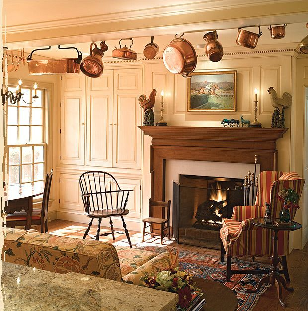 A COLONIAL DRESSED LIVING ROOM COMPLETE WITH A PANELED ...