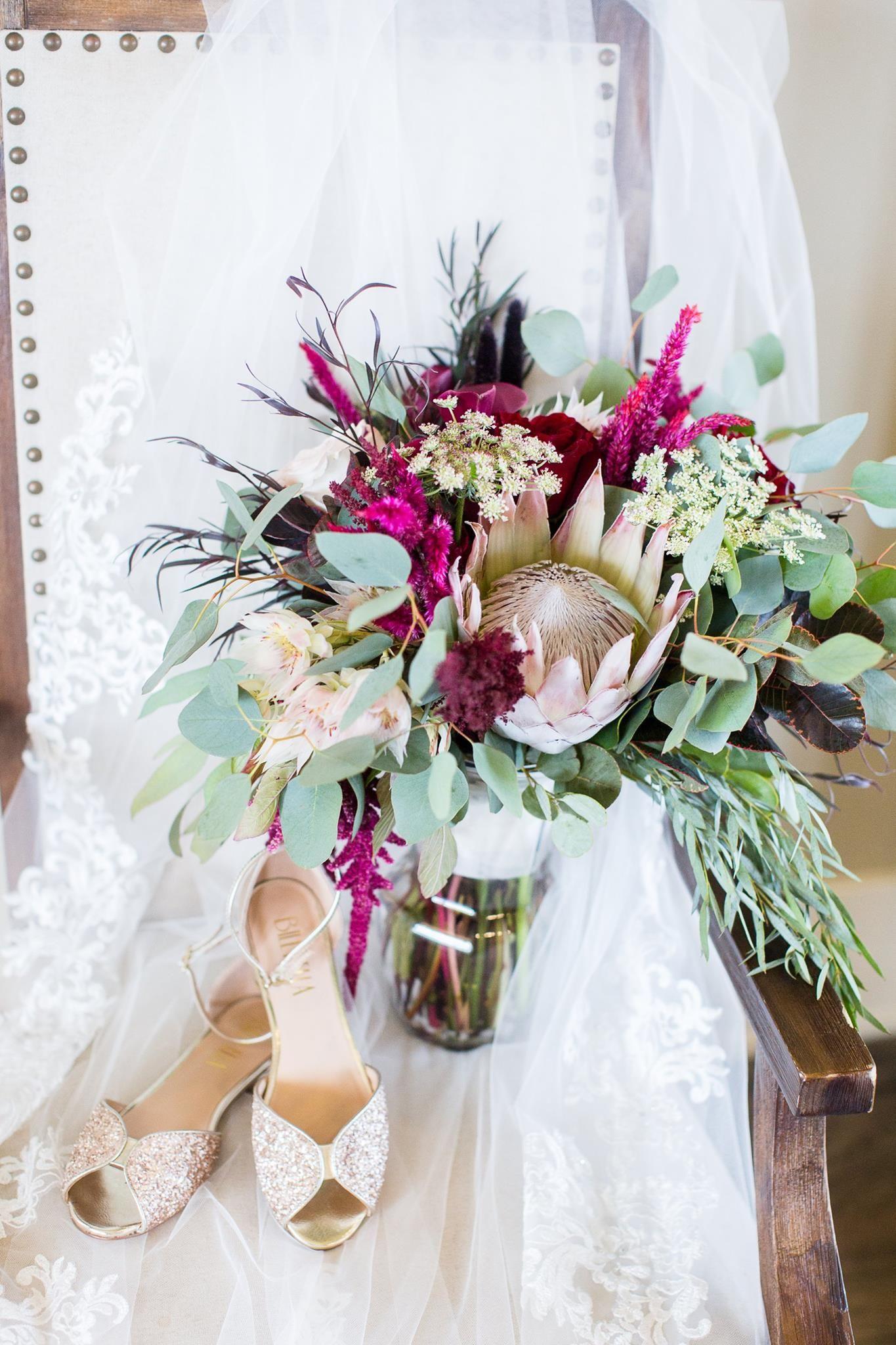 Artistic bridal bouquet featuring protea, calla lilies