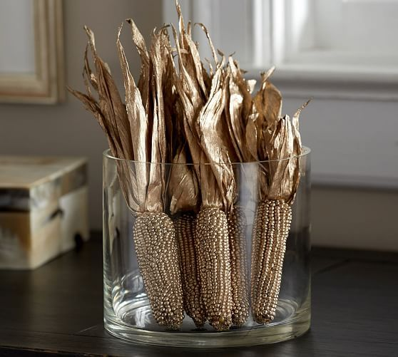 Dried Indian Corn Painted In A Metallic Gold Finish In A Glass Vase