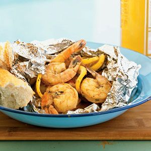New Orleans-Style Shrimp  Tips: Add 2 Tbl. Chef Paul Prudhommes Seafood Magic, extra garlic, and dried rosemary/thyme. Cut the baking time to 10-12 minutes. Fabulous!!!!