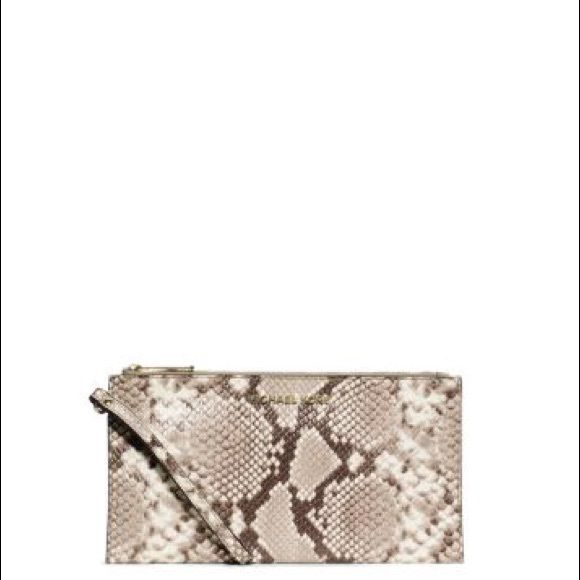 ed87f750b59a8 Natural  Python print. Perfect for a night out or to dress up any outfit! Michael  Kors Bags Clutches   Wristlets