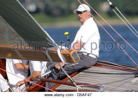 Gluecksburg, Germany, King Harald V of Norway during the sailing regatta of the Rolex Baltic Week - Stock Image