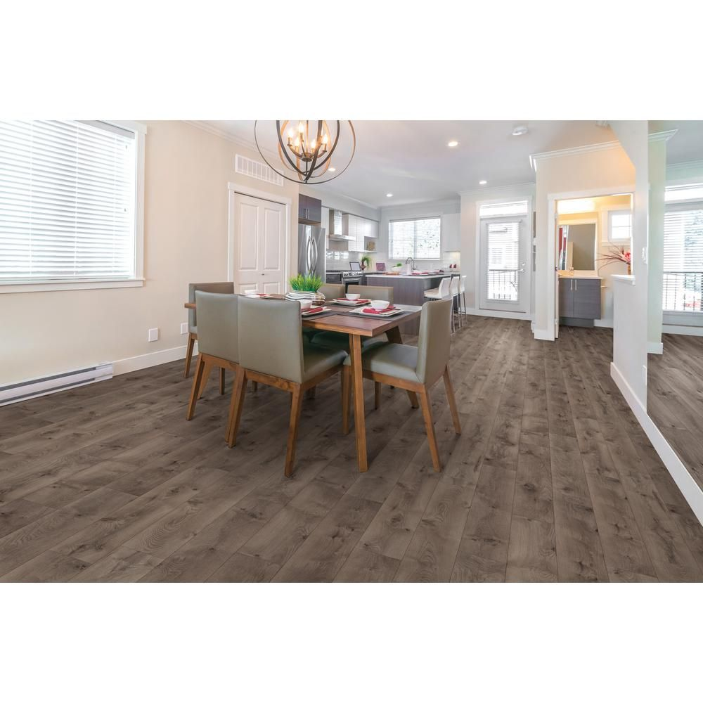 Trafficmaster Anniston Oak 7 Mm Thick X 7 2 3 In Wide X 50 5 8 In Length Laminate Flooring 24 17 Sq Ft Case 45108 The Home Depot Laminate Flooring Oak Laminate Flooring Home