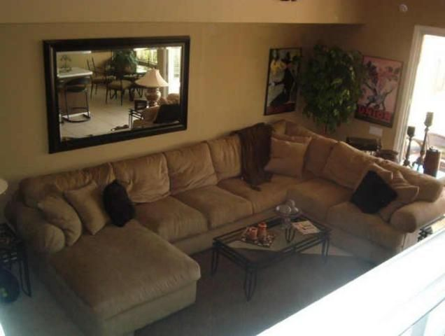 i plan on having a big wraparound sectional sofa like this