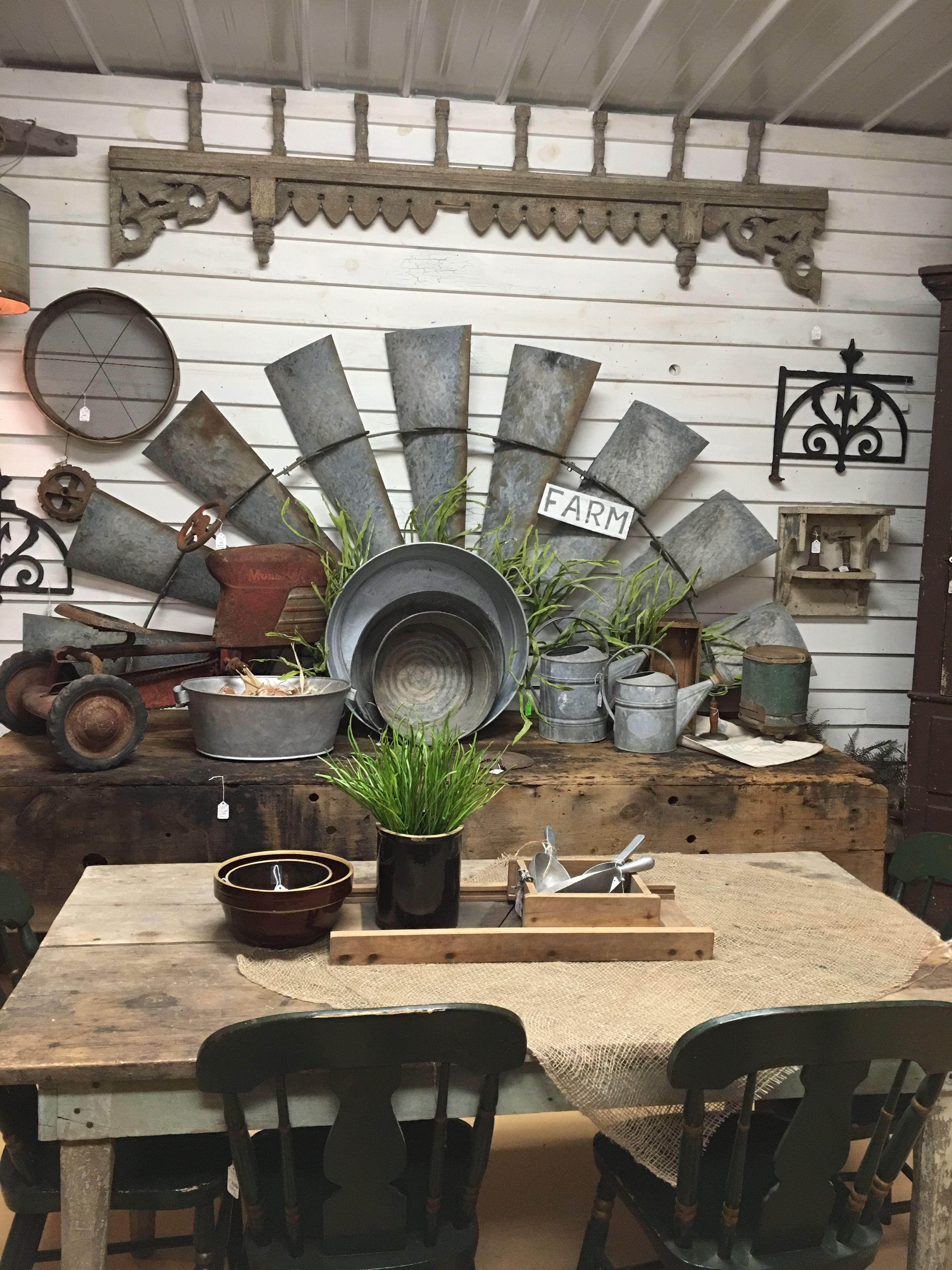 Farmhouse decorating using old galvanized rusty gold windmill blades