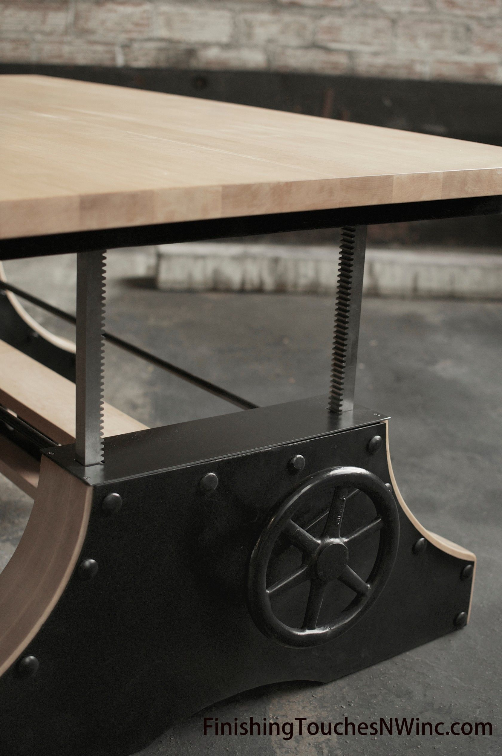Finishing touches industrial crank table one of our favorite massive coffee table that cranks into a dining table when guests are over geotapseo Image collections