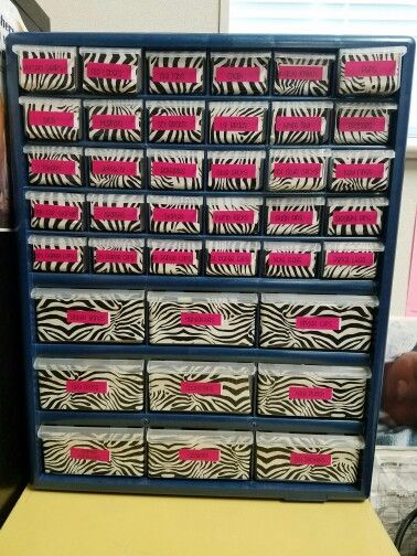 Zebra teacher toolbox made with zebra duct tape and Avery labels.