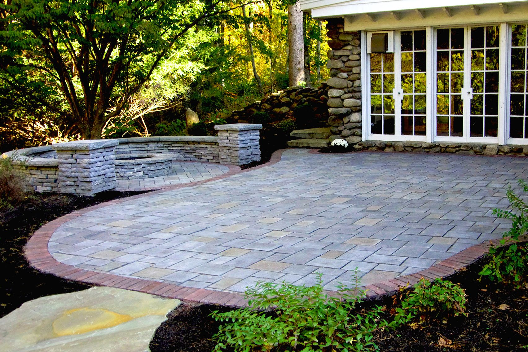 Unilock Richcliff paver patio with fire pit and Rivercrest