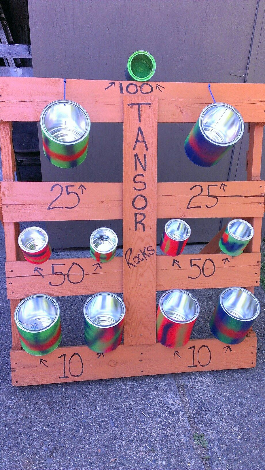 Tossing game made from a pallet and empty paint tins!