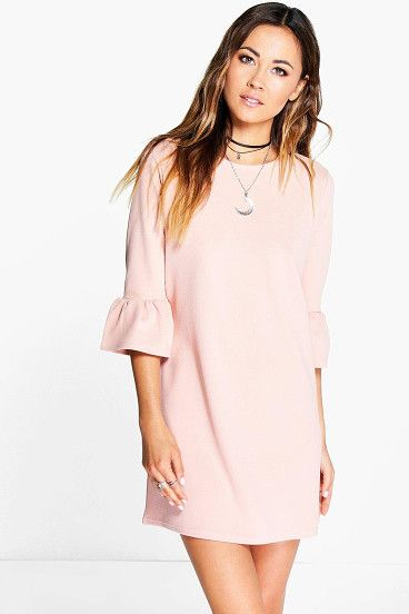 7136234d25 Casey Ruffle Sleeve Shift Dress by Boohoo. Pared back day dresses are the  perfect base for layering up this seasonNo off-duty wardrobe is complete  without a ...