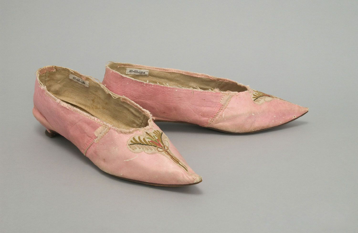 Woman's Shoes; Mid- 1790s  Medium: Pink kid leather, pink silk grosgrain ribbon, ivory ribbed silk with multicolored silk embroidery in chain stitch; white plain weave linen, leather