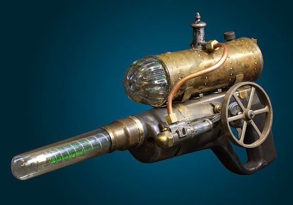 Steampunk Raygun. Steampunk weapon, Steampunk invention. A one of a kind gun made from found objects. Chrome, glass, metal.    Made with found objects. A key feature is the vial of green liquid in the barrel (not too obvious in the photos). A solid, heavy gun, not for weak wrists.    Most of my inventions use vintage or antique parts, as does this one.    Shipping and Insurance are free in the US. Will not ship overseas, or to Hawaii/Alaska.    My name is Corey Wolfe. Ive been a professi...