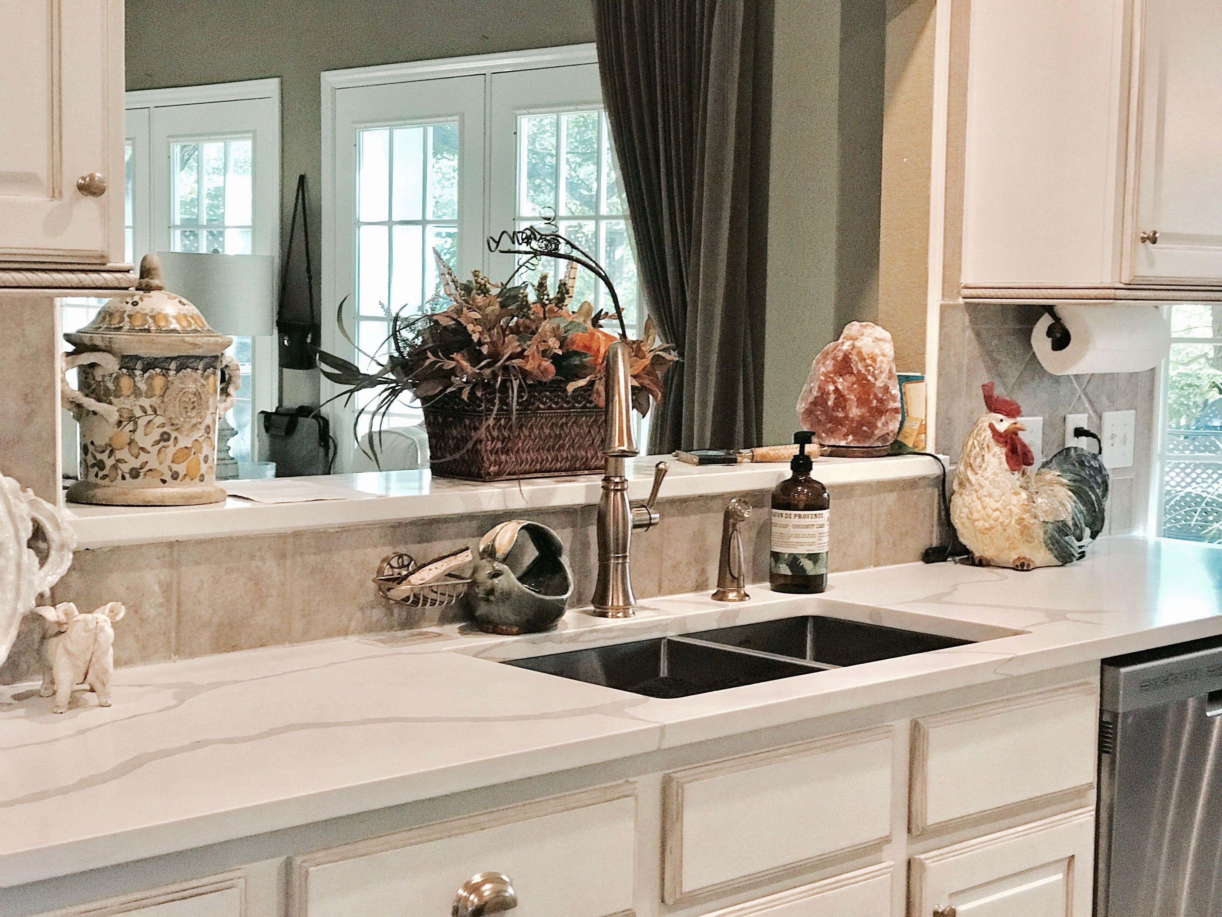 Newly updated kitchen quartz counter tops champagne bronze pull