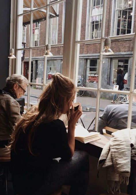 Reading or writing in a cozy coffee shop cafe | Coffee shop, Life ...