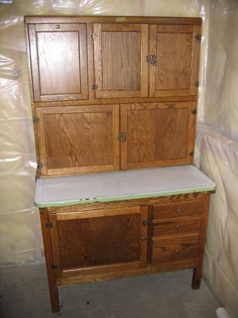 antique hoosier kitchen cabinet       this is another style i like the roll top sections usually would stick and sometimes people would remove it and add     antique hoosier kitchen cabinet       this is another style i like      rh   pinterest com