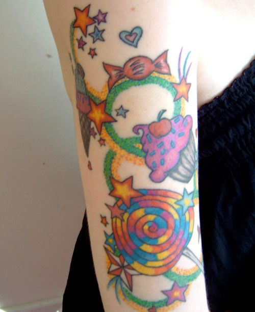 yummy sleeve tattoo bright and colorful collage of cupcake toffee candies and stars tattoos. Black Bedroom Furniture Sets. Home Design Ideas