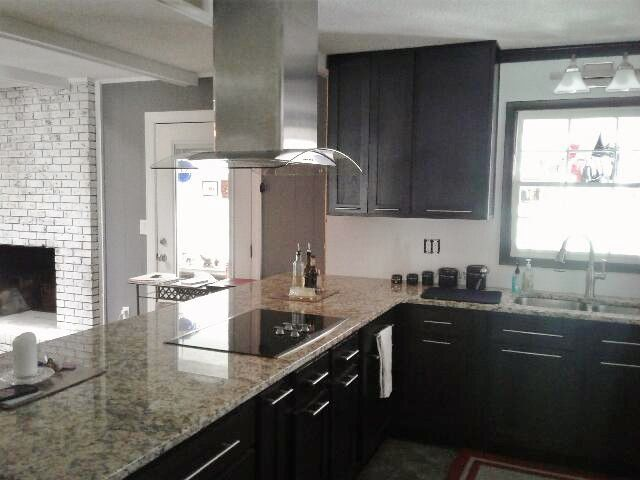 this kitchen features our stock cabinets in caf shaker with napoli granite countertops and naples - Shaker Cafe Ideas