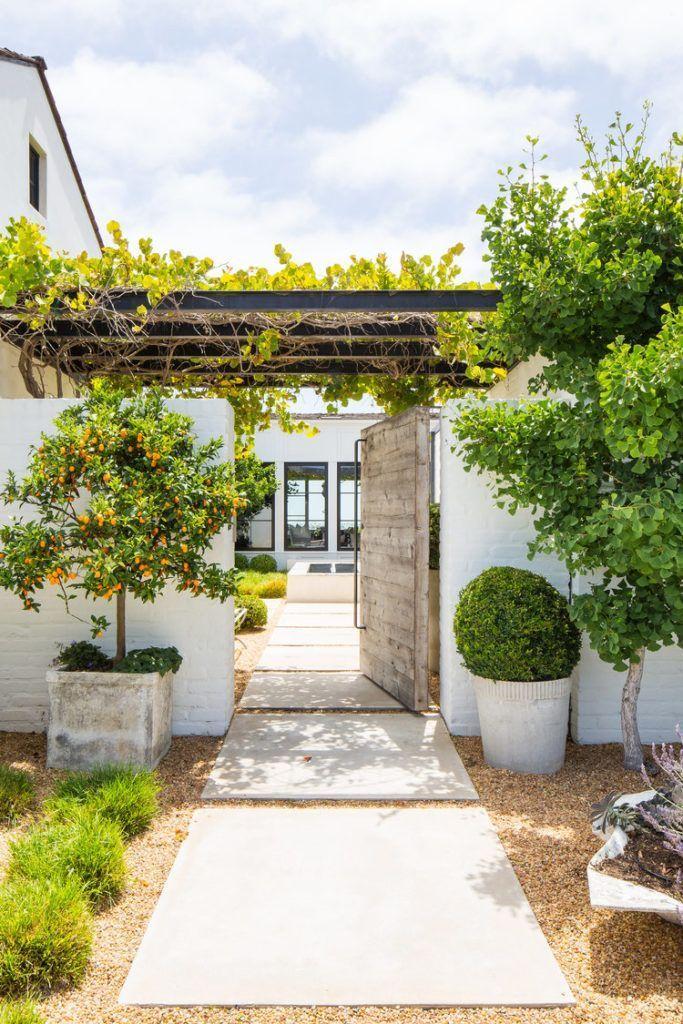 Outdoor Courtyard Ideas Gorgeous outdoor courtyard ideas with orange treem greenery and a veranda outdoorpatio outdoorfurniture outdoorspace courtyardgarden