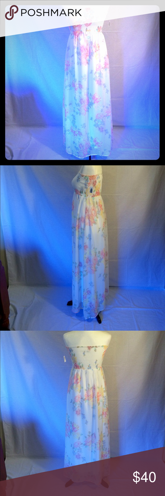 NWT Old Navy silk floral tube dress NWT women's Old Navy silk floral tube dress size medium. Underneath is silk and there's a chiffon overlay. Thick enough that it cannot be seen through...won't need a slip. This is such a gorgeous dress! Would look fantastic with any color cardigan to match. Would also look great with the brown cowgirl boots in my other listing! Old Navy Dresses Strapless
