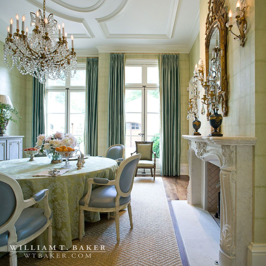William T. Baker | crystal chandelier, drapes, framed mirror, french chair, mantel, paneled ceiling, skirted table