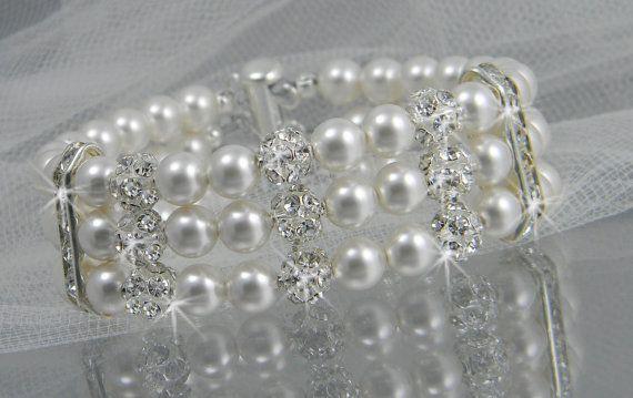 Pearl bridal Bracelet, Crystal Rhinestone wedding bracelet, Cuff bracelet, Vintage style, Holly Cuff bracelet. $58.00, via Etsy.