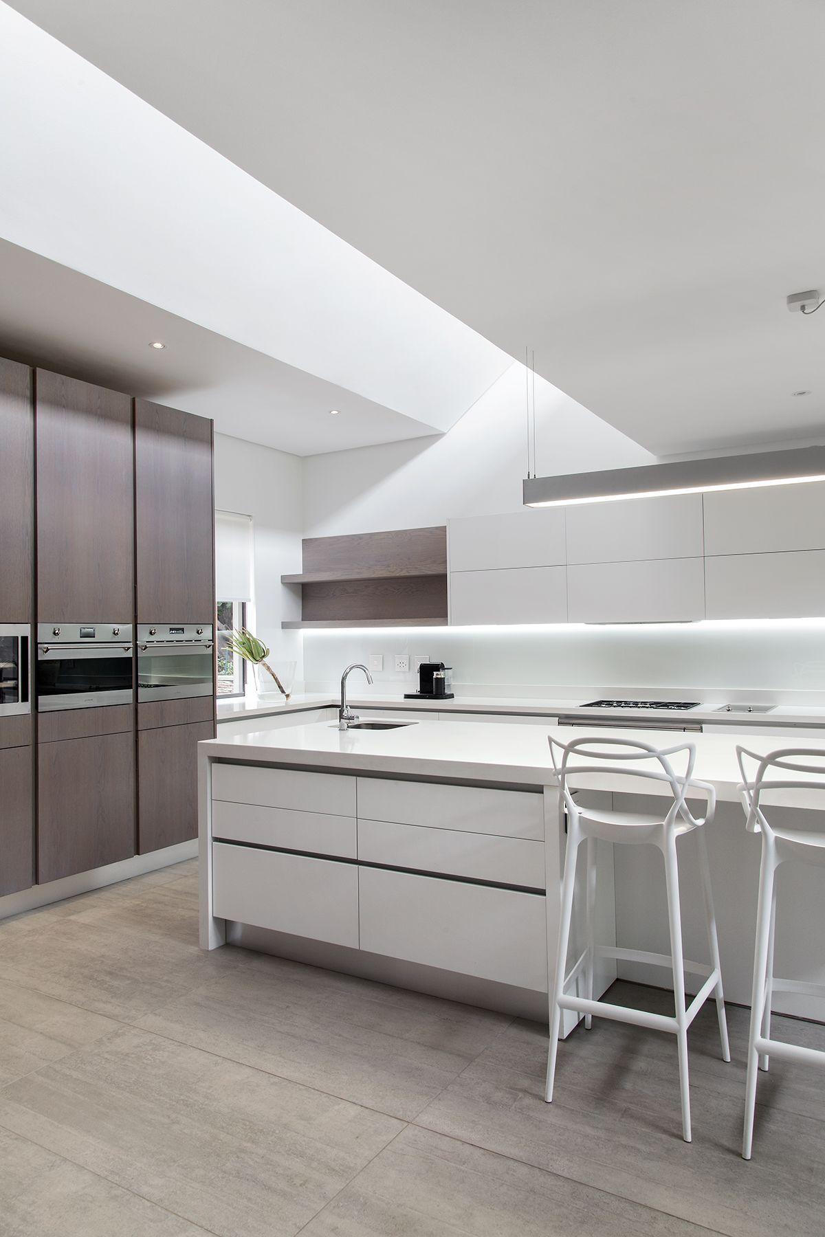 Kitchen trends. Clutter-free worktops. Handle-less units. Dark ...