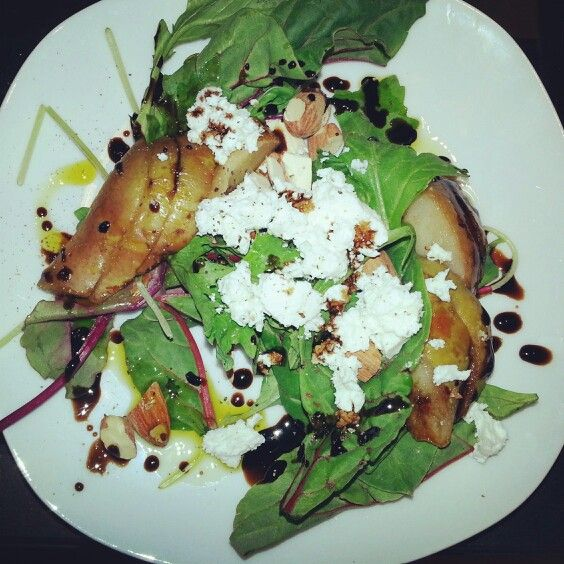 Grilled pears, goat cheese, and almonds over a field of mixed greens dressed lightly with avocado oil and a balsamic reduction.