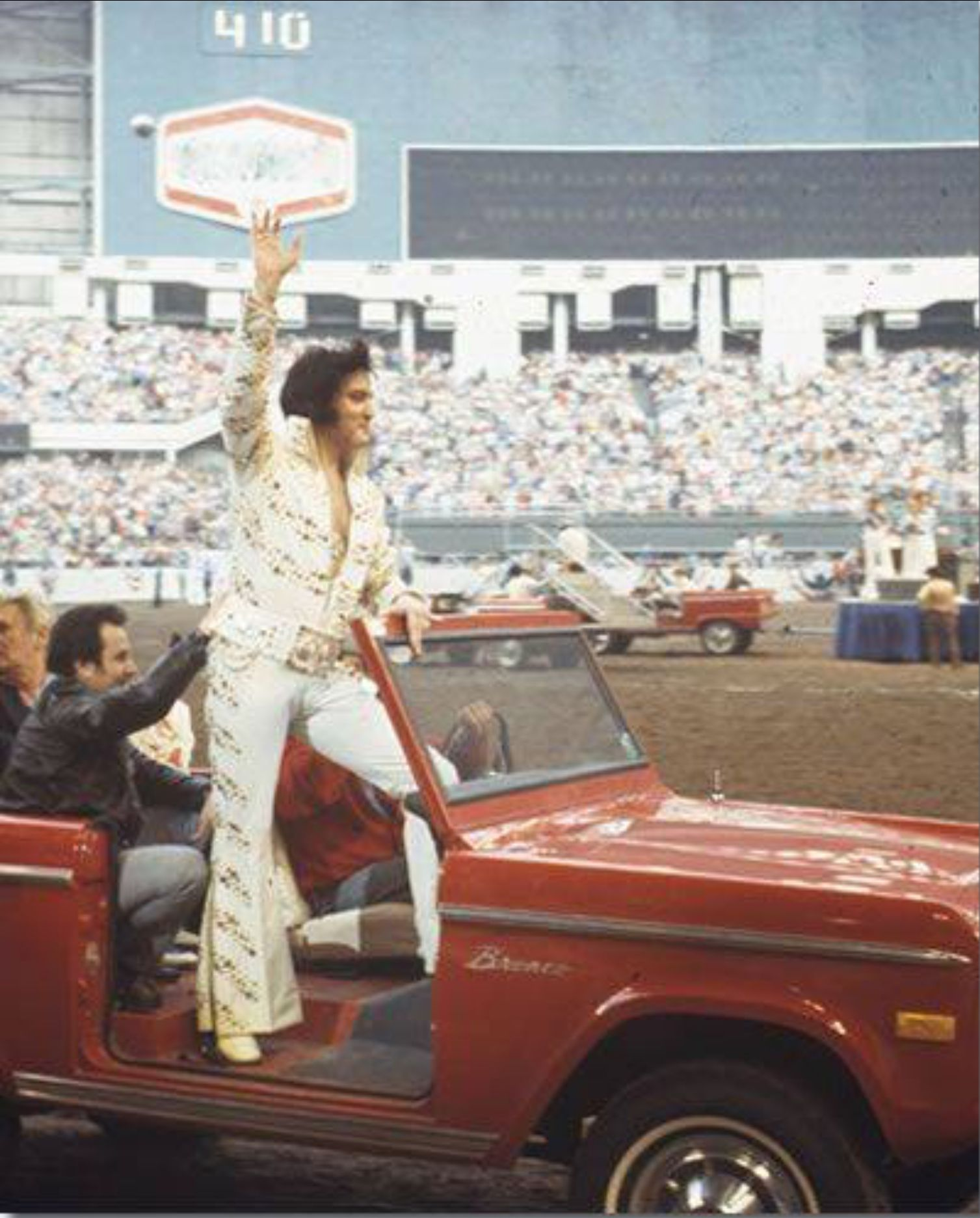 Elvis entering the Houston astrodome in a Ford Bronco   Elvis ... 8939bcfaf0