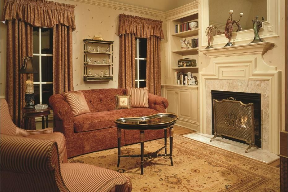 a traditional style living room with fireplace 1 of 5
