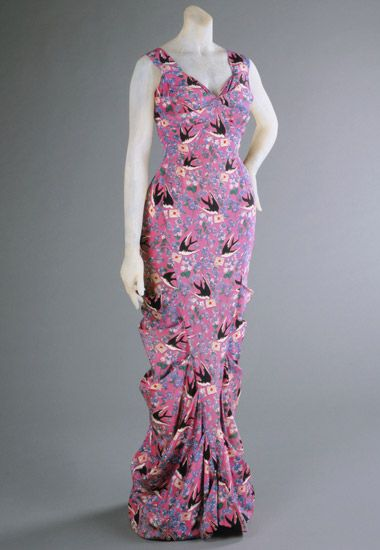 Evening dress |  Elsa Schiaparelli (Italian, 1890-1973) | France, Summer 1939 This gown features Schiaparelli's newest silhouette, which emphasized a molded sylphlike form that was to feature prominently in her August presentation for winter 1939-40.| The whimsical fabric by Ducharne features a flying swallow carrying a letter closed with sealing wax | Philadelphia Museum of Art