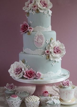Pale blue cake with pink roses and monogram. Reminds me of an extravagant and lovely tea party.