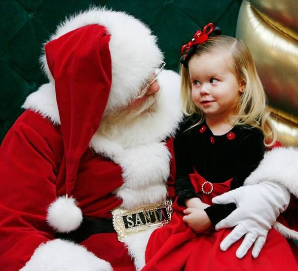 Santa Claus talks with Sienna Smithson, 2, at Penn Square Mall Friday afternoon, Dec. 12, 2008. Smithson is from Yukon, Okla.  (BY JIM BECKEL, THE OKLAHOMAN)